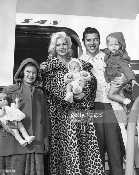 American actress Jayne Mansfield at Los Angeles airport with her husband muscleman Mickey Hargitay and their children Jayne Marie Zoltan and Miklos...