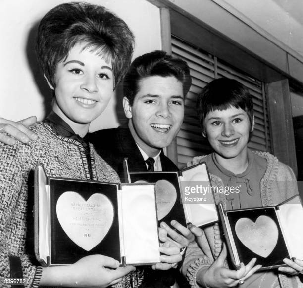 Singer Helen Shapiro and actress Rita Tushingham winners of Variety Club Awards for Most Promising Newcomers with singer Cliff Richard at the Savoy...
