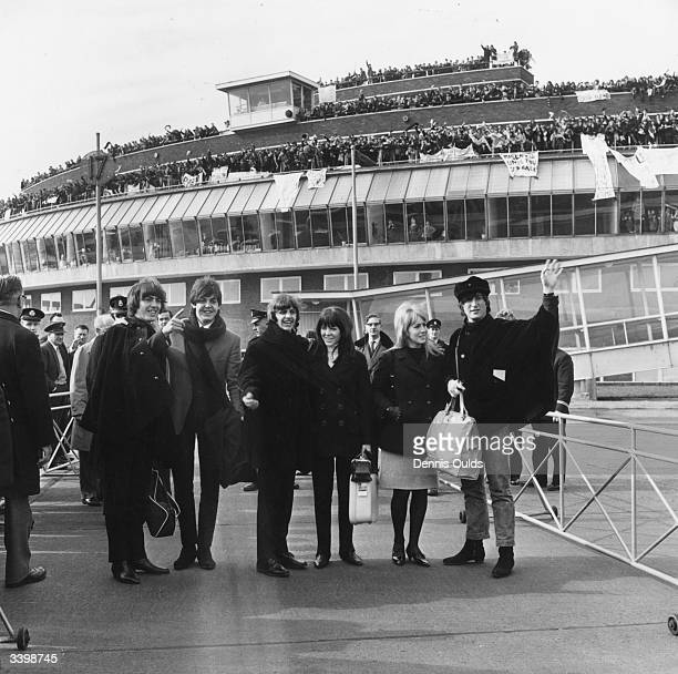 British pop band The Beatles bidding farewell to their fans at London Airport as they leave to continue production of their film 'Help' in Austria...