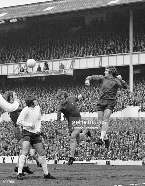 Tommy Baldwin of Chelsea loses out in the air to Tottenham Hotspur goalkeeper Pat Jennings