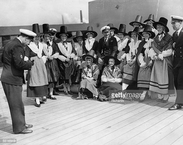 Miss Dolan Evan's Ladies Choir being photographed on board HMS Neptune in Cardiff Docks south Wales