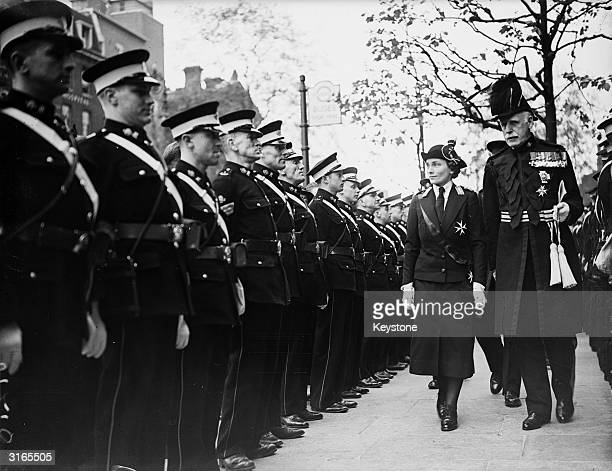 Princess Alice the Duchess of Gloucester inspecting a St John's Ambulance Guard of Honour at the Great Central Hotel London Sir John Duncan the Chief...