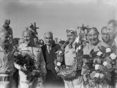 British racing driver Reg Parnell Italian driver Giuseppe Farina and Italian C Fagioli members of the victorious Alfa Romeo team at the finish of the...