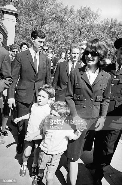 Jackie Kennedy widow of John F Kennedy walking in Green Park London with her son John Jr and Anthony the son of her sister Lee Radziwill
