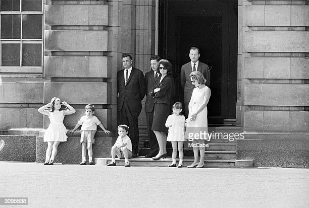 Jackie Kennedy widow of John F Kennedy watching the changing of the guard at Buckingham Palace London with her children John Jr and Caroline her...
