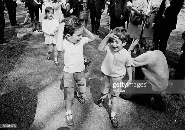 John F Kennedy Jr the son of Jackie Kennedy and the late American president walking in Green Park London with his cousins Anthony and Tina the...
