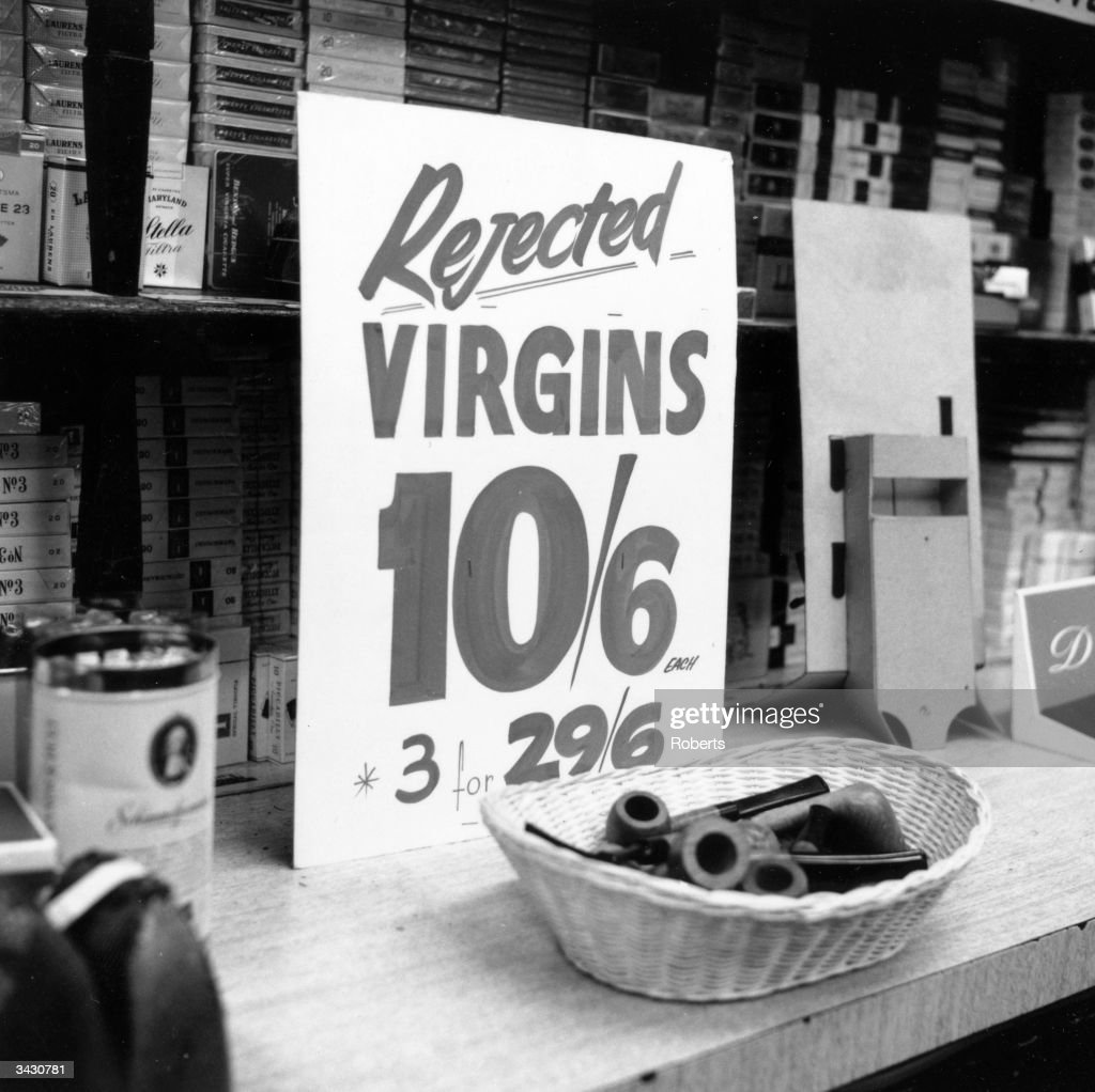 A sign offering a brand of briar pipes for sale at a reduced rate at Coleman Cohen tobacco shop in Old Compton Street, Soho, London.