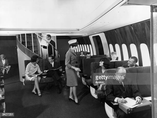 A demonstration of the new Boeing 747 passenger plane under development Due for completion in 1969 the craft is so large it includes a stairway...