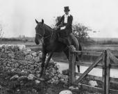 Mrs Dominick Browne a member of the Galway Blazers hunt riding sidesaddle jumps a stone wall during the meet at Atherny County Galway