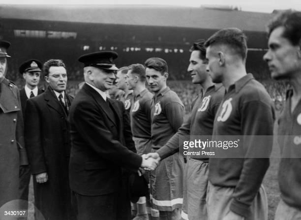 British Labour politician Albert Victor Alexander greets members of the Dynamo Moscow football team before their game against Chelsea at Stamford...