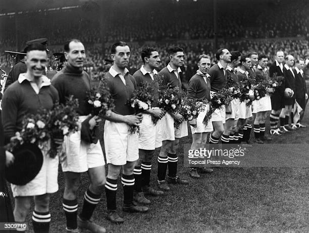 Chelsea line up at Stamford Bridge with the bouquets of flowers presented to them by the Moscow Dynamo team before their match