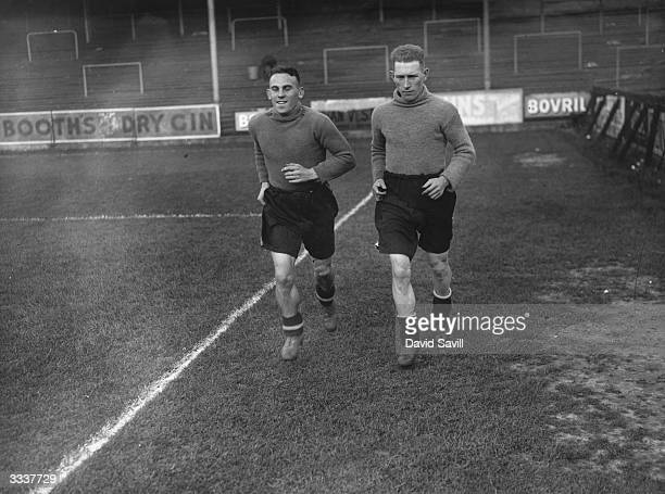 Two Brentford football players Scott right and Hopkins in training at Griffin Park Brentford Middlesex