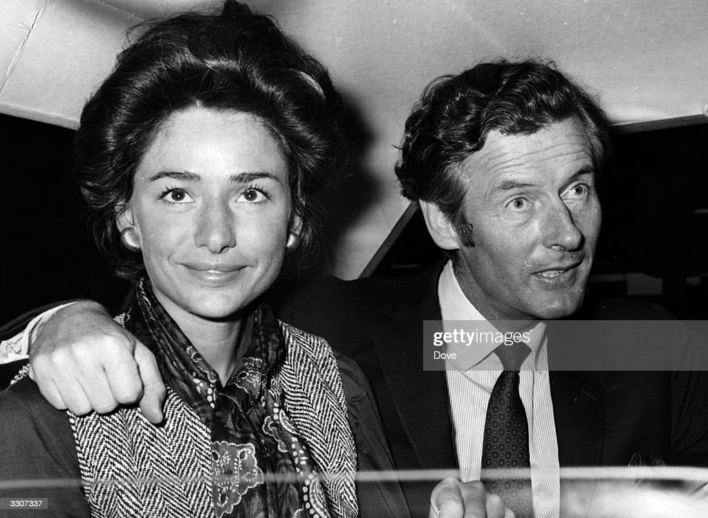 Group Captain Peter Townsend and his wife Marie Luce, in a car at Heathrow airport.