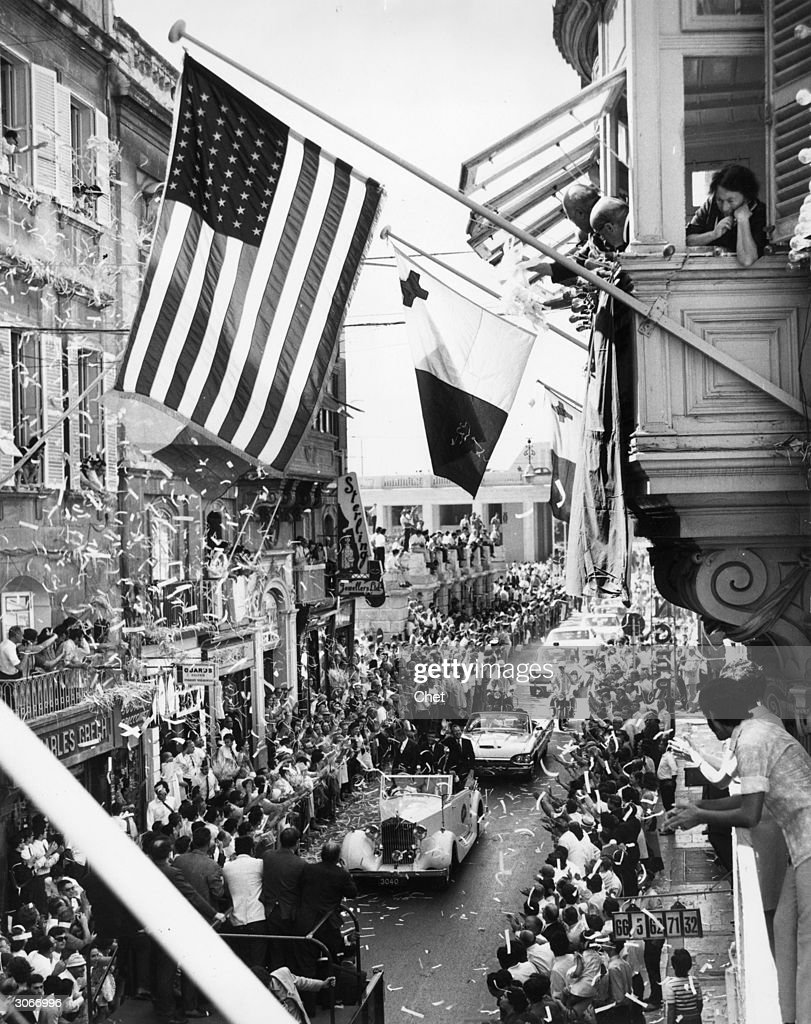 Ticker-tape welcome for Apollo 13 astronauts James Lovell, Fred Haise and John L Swigert as they drive in an open Rolls-Royce along Kingsway, the main street in Valletta, Malta.