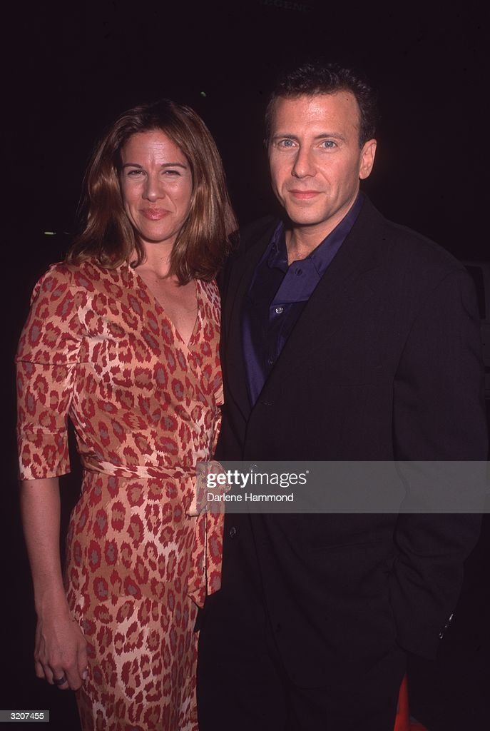 American actor Paul Reiser with his wife Paula Ravets at Mann National Theater for the premiere of director Rob Reiner's film 'The Story of Us,' in which Reiser appears, Westwood, California. Ravets is wearing a jungle print dress.
