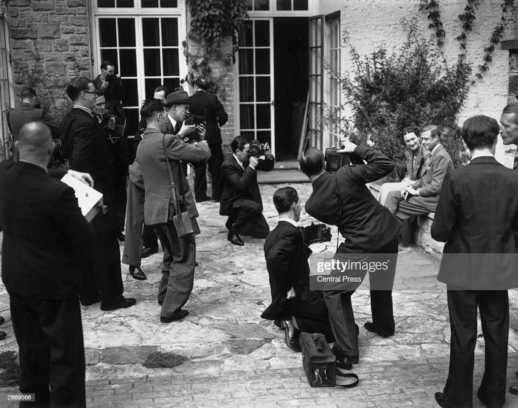The Duke and Duchess of Windsor photographed by various members of the press at their temporary home in Sussex.