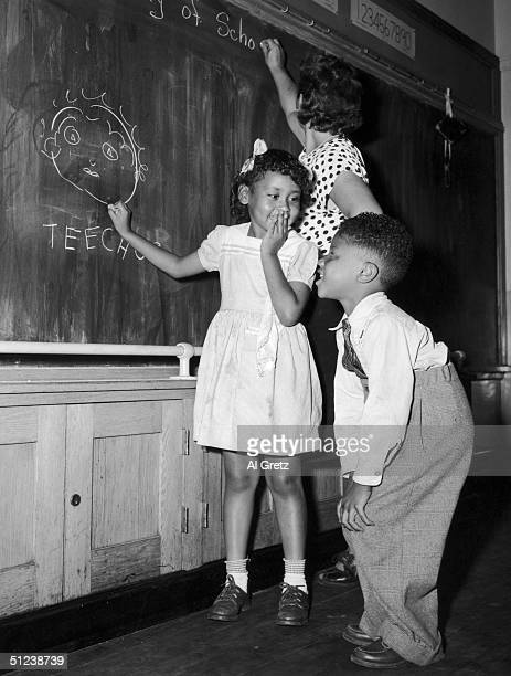 13th September 1948 Joyce Payne and Vincent Baker draw an unflattering portrait of their teacher on their first day at a Harlem School New York