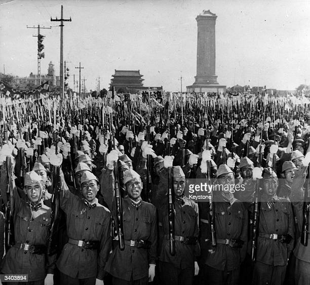 Members of the Chinese People's Liberation Army shouting slogans on the streets of Peking in support of Premier Chou Enlai's statement on the...