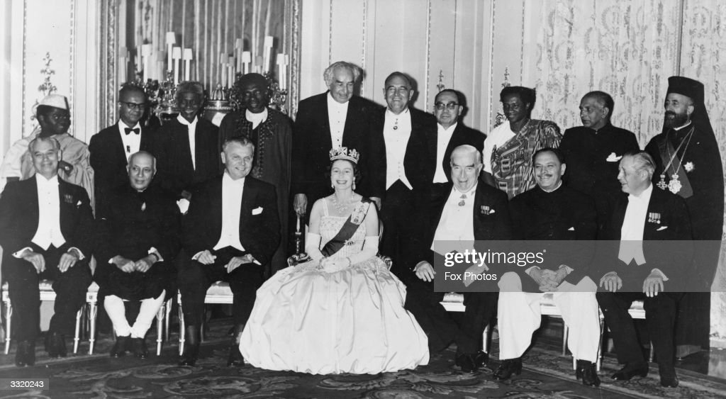 Queen Elizabeth II poses with the Commonwealth Ministers at a banquet in Buckingham Palace, London. From left to right, the group includes (standing) Rashidi Kawawa, Trinidadian Prime Minister Dr Eric Williams, Sierra Leonese Prime Minister Sir Milton Margai, Nigerian premier SIr Abubakar Tafawa Balewa, Jamaican Prime Minister Sir William Alexander Bustamante, Rhodesian Prime Minister Sir Roy Welensky, Malaysian Prime Minister Tun Abdul Razak, F D A Goka, Senator Fernando, Cypriot President Archbishop Makarios III, (sitting) New Zealand Prime Minister Sir Keith Holyoake, Indian Prime Minister Jawaharlal Nehru, Canadian Prime Minister John Diefenbaker, the Queen, Australian politician Sir Robert Menzies, Pakistani President Muhammad Ayub Khan, and British Prime Minister Harold MacMillan.