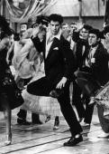 Singing and dancing actor John Travolta struts his stuff in the hit musical film 'Grease' a romantic comedy set in the 1950's rock 'n' roll era in...