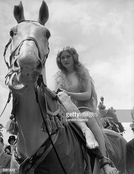 13yearold convent schoolgirl Mirabelle Muller rides through Teddington during the town fete taking the role of Lady Godiva an English noblewoman of...
