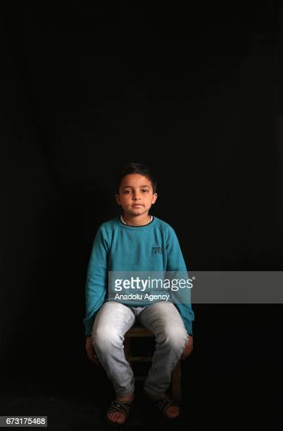 13yearold hearing impaired Syrian war victim Mohammed Abdo who fled from his house due to ongoing civil war is seen in Gaziantep Turkey on April 12...