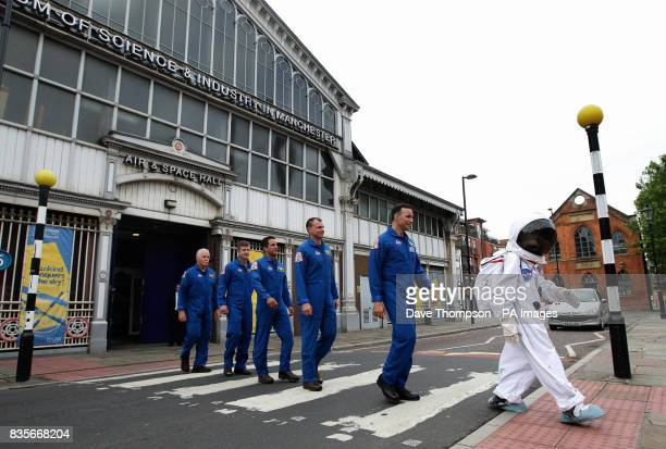 13yearold Josh Ellis leads astronauts from the space shuttle Discovery who have just returned from the International Space Station out of the Museum...
