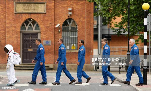 13yearold Josh Ellis leads astronauts from the space shuttle Discovery who have just returned from the International Space Station into the Museum of...
