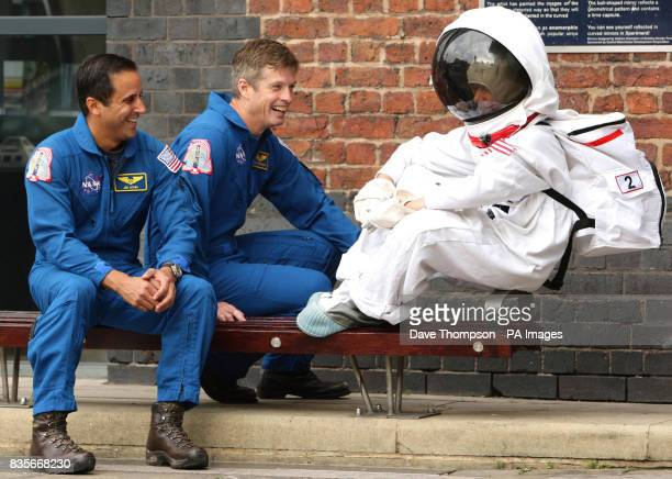 13yearold Josh Ellis talks to Joe Acabo left and Steve Swanson from the space shuttle Discovery outside the Museum of Science and Industry in...