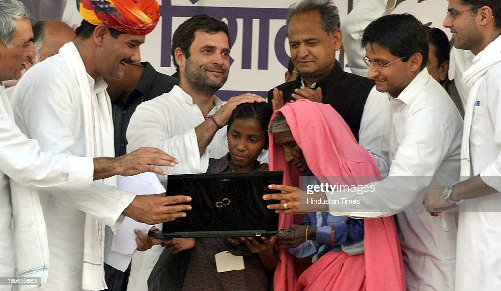 A 13-year-old village girl Nitu Saini blessed by Congress Vice President Rahul Gandhi after she launched the party website in the presence of Rahul Gandhi and Rajasthan Chief Minister Ashok Gehlot during his rally at Kherli on October 23, 2013 in Alwar, India. Addressing a rally in the poll-bound Rajasthan, Congress Vice President said the party's election manifesto will not be prepared in closed rooms this time around as people's suggestions will be included. Website will be used to collect feedback and suggestions from people for preparing the party's poll manifesto.