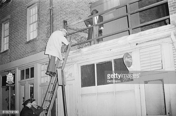 1/4/1964Boston MAPolice check adjoining roof to apartment rear of the building where Mary A Sullivan of Hyannis MA was found strangled to death 1/4...