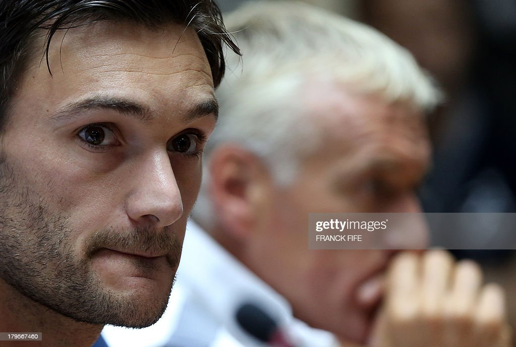 14French national football team's captain Hugo Lloris (L) and head coach Didier Deschamps arrive for a press conference on September 5, 2013, on the eve of their FIFA World Cup 2014 qualifying football match Georgia vs France at the Boris Paichadze stadium in Tbilisi. AFP PHOTO / FRANCK FIFE