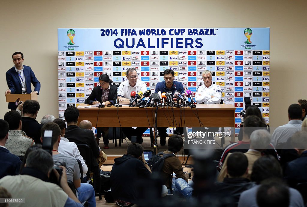 14French national football team's captain Hugo Lloris (2nd R) and head coach Didier Deschamps (R) give a press conference on September 5, 2013, on the eve of their FIFA World Cup 2014 qualifying football match Georgia vs France at the Boris Paichadze stadium in Tbilisi. AFP PHOTO / FRANCK FIFE