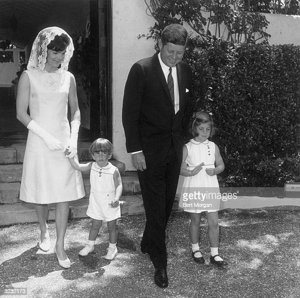 EXCLUSIVE President John F Kennedy with his wife Jacqueline Bouvier Kennedy son John F Kennedy Jr and daughter Caroline in front of his father's...