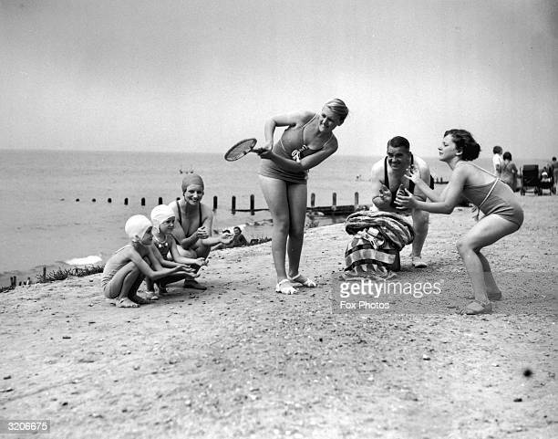 The family and friends of British comedy actor Jack Hulbert playing beach cricket while on holiday at Felpham Sussex