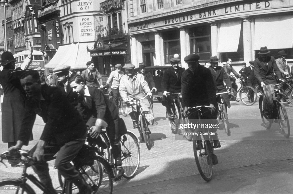Cyclists riding through the streets of Portsmouth Picture Post 202 Portsmouth pub 1939