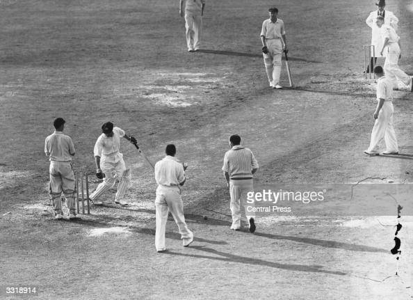 Australian cricketer Don Bradman is bowled for a duck by a googly from Hollies during Australia's first innings in the final test match against...
