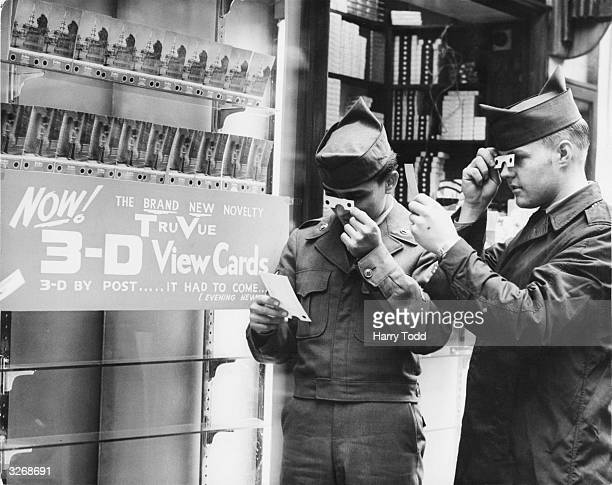 Two US Air Force men take a look at the new TruVue 3D postcards on sale at the Quality Inn in Coventry Street in central London They are Dave Heredis...