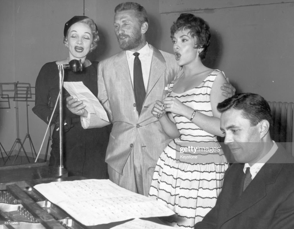 The actors Marlene Dietrich (1901-1992), Kirk Douglas and Gina Lollobrigida rehearse for a charity concert in Paris.