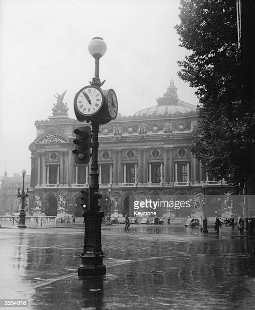 The Opera House on the Place de l'Opera where only a few people are walking on account of the exodus from Paris in the summer holiday season