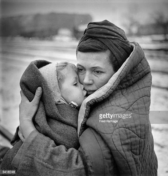 A mother clutching her child in Berlin after surviving a 'Death March' from Lodz which they embarked upon in the hope of finding food and shelter in...