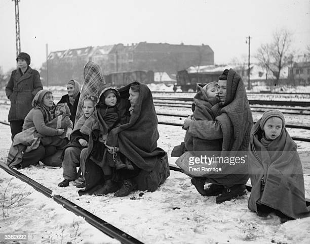 Huddling in blankets the only survivors of an original 150 Polish people who walked from Lodz in Poland to Berlin hoping to find food and shelter...
