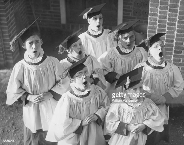 Choir boys practice carol singing at the St Maryofthe Angels Song School in Woburn Hill near Weybridge in Surrey England