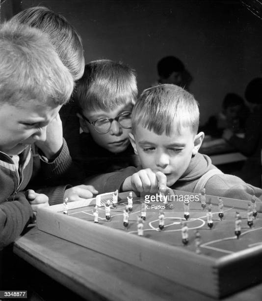Boys playing a game of table football at the Children's Club in Budapest