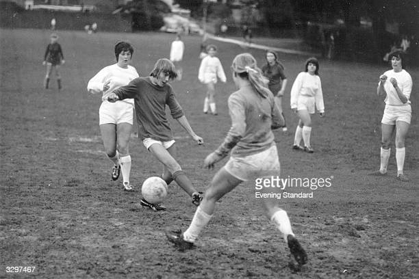 A group of women play football