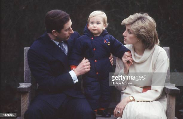 Prince Charles and Princess Diana with their son Prince William in the gardens of Kensington Palace
