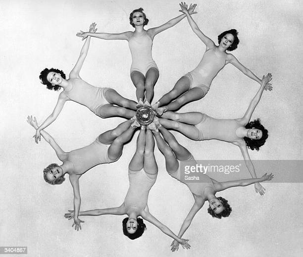 The Albertina Rasch chorus girls who are currently appearing in 'Wild Violets' at the Drury Lane Theatre London lie down to form a sevenpointed star