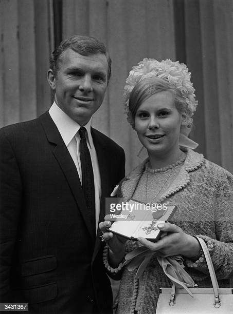 West Ham and England captain Bobby Moore with his wife Tina after receiving the OBE at Buckingham Palace
