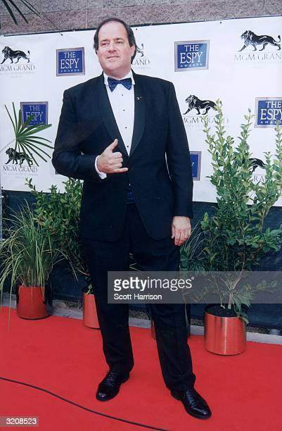 Fulllength image of ESPN football commentator Chris Berman making a hand sign while standing on the red carpet at the eighth annual ESPY Awards MGM...
