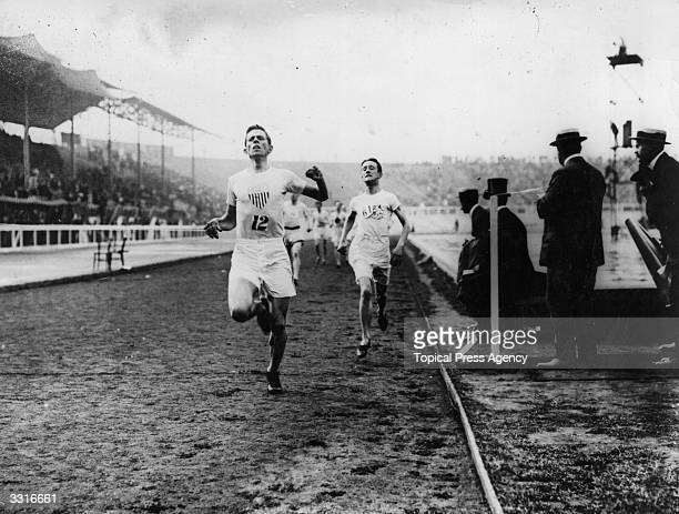 Melvin Sheppard of the USA crosses the finish line to win the final of the 1500 Metres at the 1908 London Olympics from Harold Wilson of Great...
